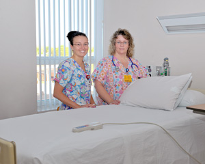 nurses at bed